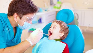 40826413-small-kid-patient-visiting-specialist-in-dental-clinic